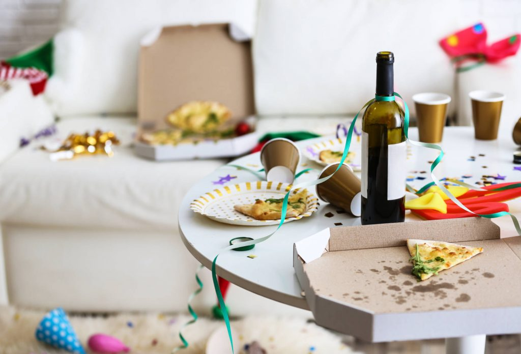 party mess vacation rental guests pizza wine confetti