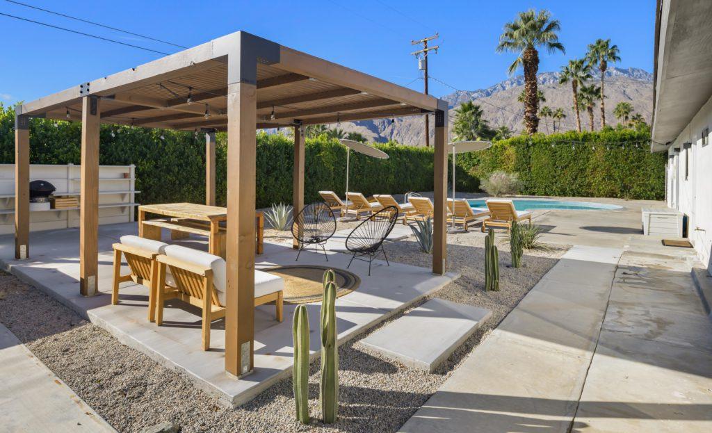 outdoor patio pool vacation rental palm trees pergola deck