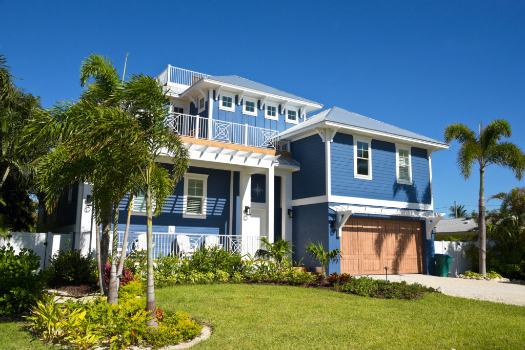 florida vacation rental deck balcony palm trees lawn invest