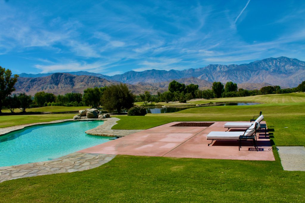 rancho mirage estate pool chaise desert skies golf course