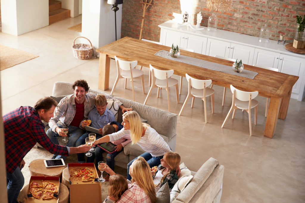 young guests dinner party vacation rental