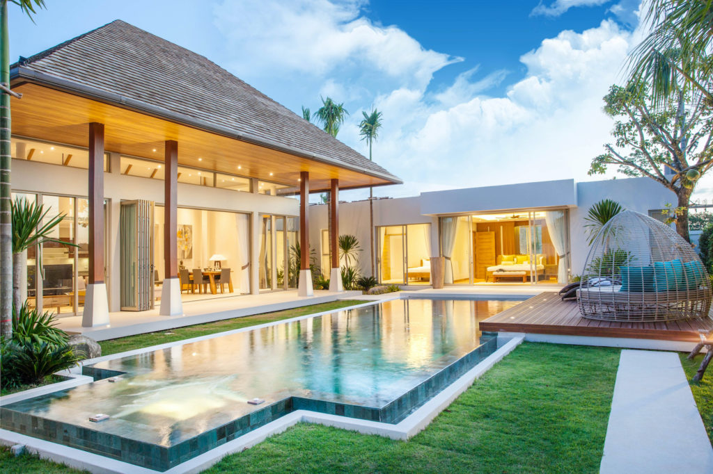 luxury vacation rental home pool lawn palm trees 2021 summer travel