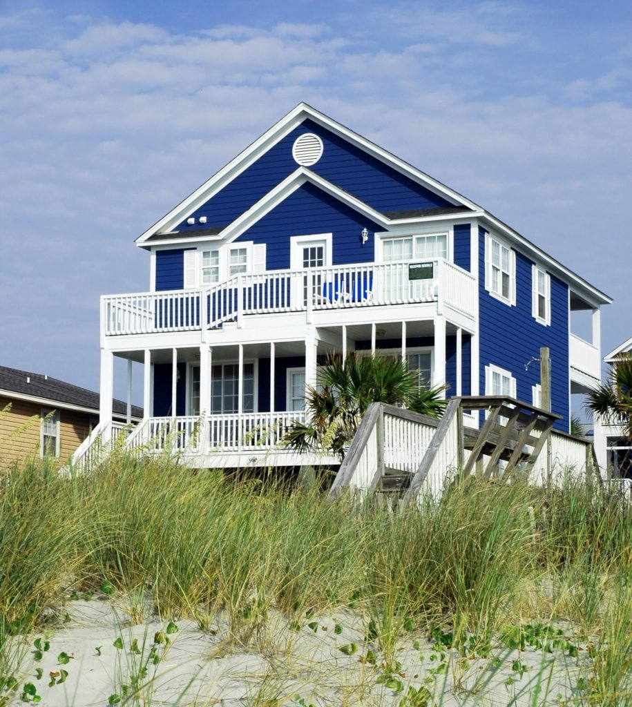 blue beach house vacation rental property manager