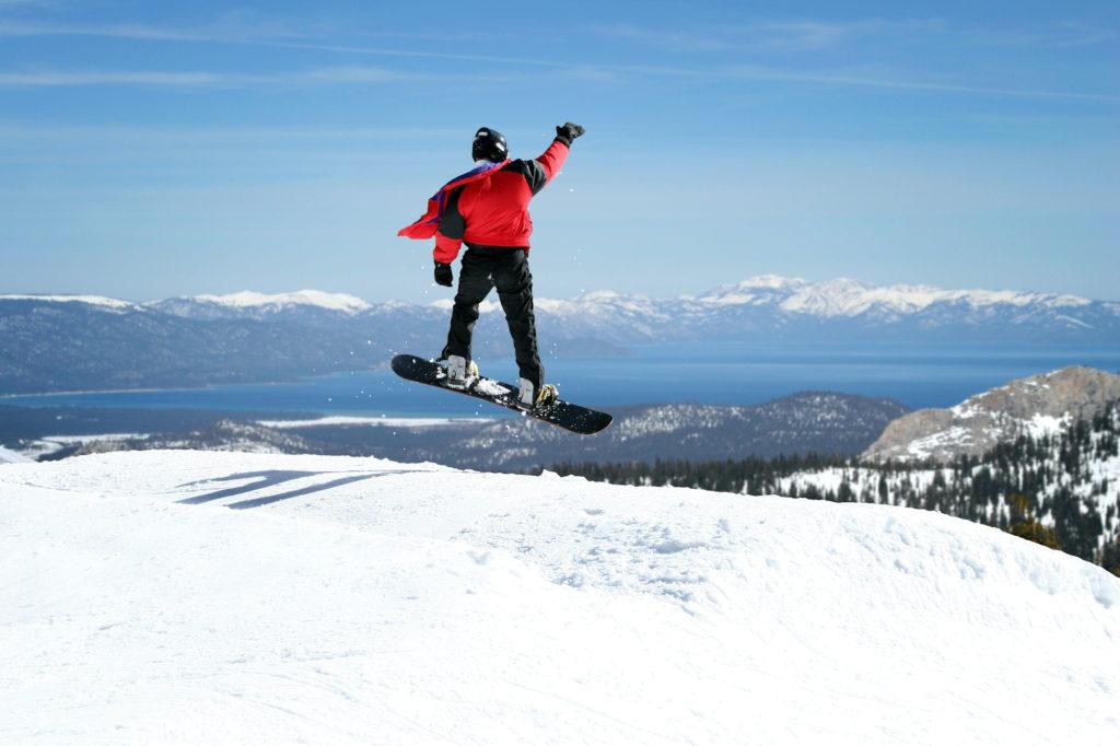 snowboarder mountain waving view vacation rental winter